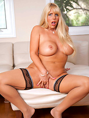 Busty blonde cougar Karen Fisher finger fucks her mature pussy