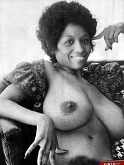 Black retro babe showing her massive natural boobs