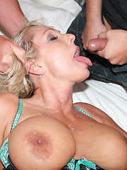 Blonde with huge tits gets plowed by a pack of horny guys