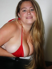 Silvia Calibresa posing giant tits in red bikini.