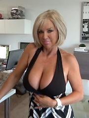 Busty Blonde MILF Swallows Cum Under Milking Table