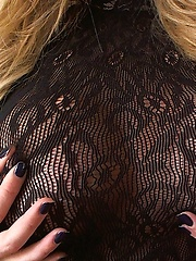 Gisele wears a tight black lace bodysuit that does not stay on for long